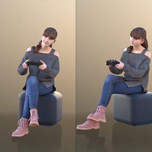 girl sitting playing 3D
